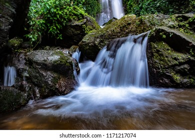 Beautiful water flow deep forest waterfall in Nakorn Nayok, Thailand. Slow shutter speed with selective focus.