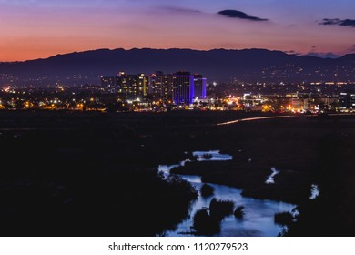 Beautiful water reflecting the sky in the Ballona Wetlands with city lights from Marina Del Rey in the background after sunset, Playa Vista, California