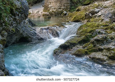 A beautiful waterfall at the Austrian alps. Long exposure image with flowing water. The water comes out of the mountains and has drinking quality.
