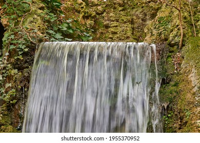 Beautiful waterfall. Autumn nature. Water that falls from the stone slope.