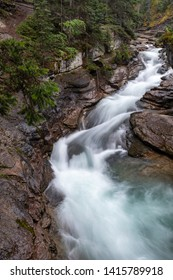 a beautiful waterfall cuts through the rocks at Maligne Canyon, Jasper National Park, Canada, long exposure to create blurred motion to the water.
