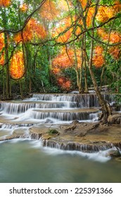 Beautiful waterfall in deep forest with soft focus