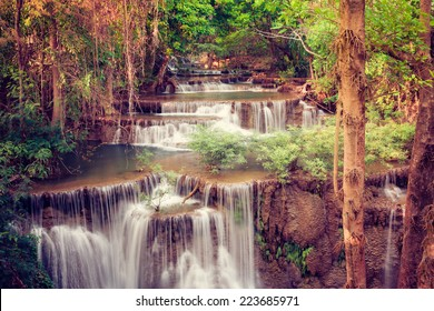 Beautiful waterfall in deep forest, Thailand.Retro filter.