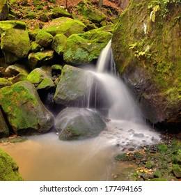 Beautiful waterfall in the deep valley near national park Bohemian Switzerland