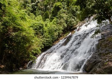 Beautiful waterfall flowing through a tropical rain forest in Thailand (Ton Prai, Lam Ru, Thailand)