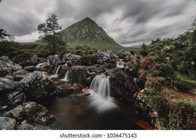 Beautiful waterfall in front of the Buachaille Etive Mòr, Glen Etive Highlands of Scotland.