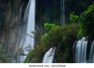 Beautiful waterfall in the green forest. Great waterfall in Thailand. Waterfall in tropical forest at Umpang National park, Tak, Thailand.