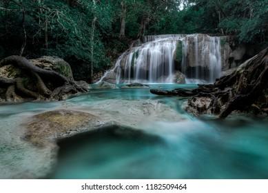 Beautiful waterfall green tone forest, Kanchanaburi province, Thailand