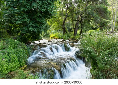 Beautiful waterfall hidden in the middle of the lush green forest in the Krka National Park, Croatia 2021