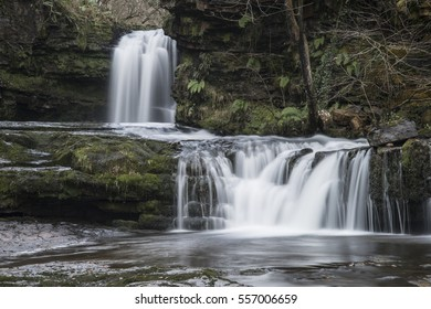 Beautiful waterfall landscape image in forest during Autumn Fall