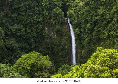 Beautiful waterfall from the middle of the lush green  Costa Rican rain-forest.