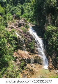 Beautiful waterfall in the mountains of Vietnam. Fresh air and sunny day