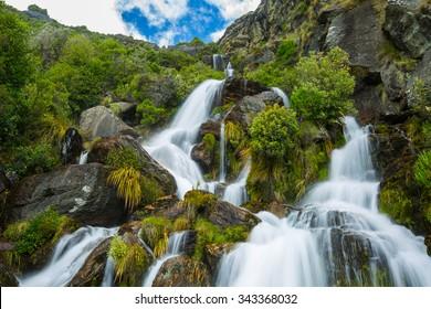 beautiful waterfall on Lower Wye Creek track in Queenstown, New Zealand