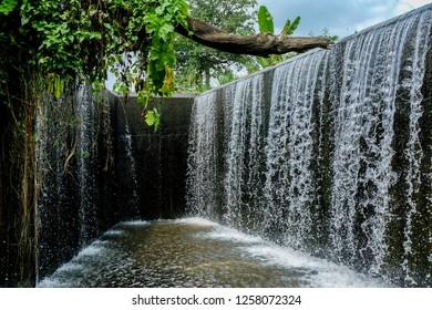 Beautiful waterfall at Pang Sawan Dam and Reservoir , Uthai Thani province , Thailand.