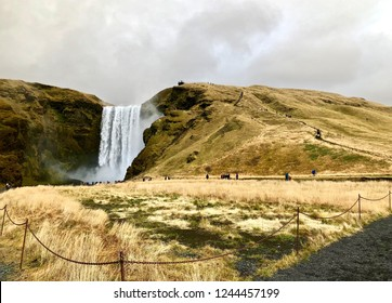 Beautiful Skógafoss Waterfall with rainbow on a cloudy day: South of Iceland