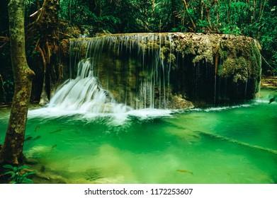 Beautiful waterfall in the rainforest jungle of thailand. Erawan waterfall in Erawan National Park, kanchanaburi,Thailand