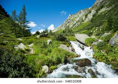 A beautiful waterfall in a remote valley in the Hohe Tauern nature reserve in the Austrian Alps on a sunny summer's day.