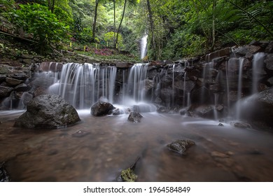 Beautiful waterfall and river in the forest at Trawas, Mojokerto, East Java, Indonesia, Noise and Grainy image - Shutterstock ID 1964584849