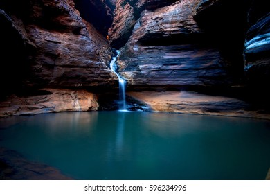 Beautiful waterfall in rock gorges, deep and cool, calm and peaceful, karijini western australia