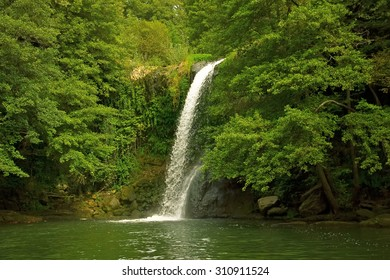 Beautiful waterfall in the rocks. Fresh and clean little river, a relaxing place in the mountain