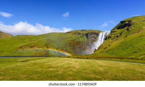 beautiful waterfall Skogafoss with rainbow, famous natural landmark in Iceland