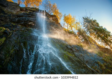 Beautiful Waterfall in sun light, National Park Harz in Northern germany
