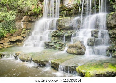 A beautiful waterfall in Zilker Botanical Garden, which is a hidden oasis of lush plants and trees located just minutes from downtown Austin, Texas.