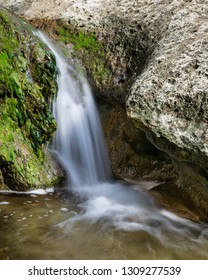 Beautiful waterfalls are found along the small stream that follows the Little Fern hiking trail in the River Place neighborhood in north Austin, Texas. The trail is a popular natural urban getaway.