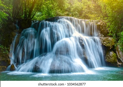 Beautiful waterfalls in the middle of the forest, resulting in complete ecological system of the forest.