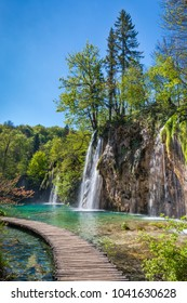 Beautiful waterfalls plunging in emerald, crystal clear lakes, Plitvice National Park, Croatia