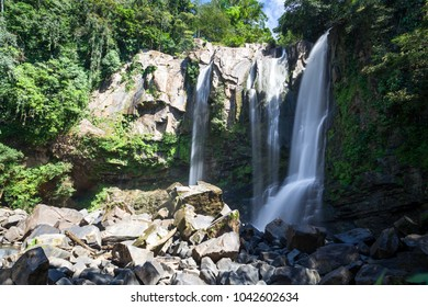 beautiful waterfalls in the south pacific of Costa Rica, Nauyaca falls surrounded by dense vegetation.