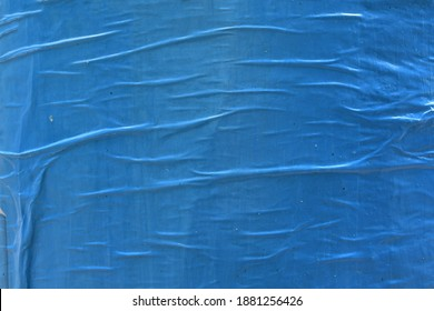 Beautiful waved creased blue street poster paper texture, creative abstract street appeal flyer background texture