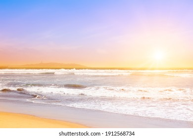 Beautiful waves of the pacific ocean at sunset in La Serena, Chile