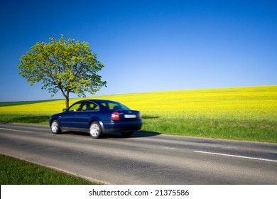 Beautiful weather 7. - beautiful day. Yellow field with blue car