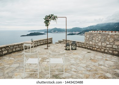 Beautiful wedding arch with flowers on the background of the sea in Montenegro. Preparation for a wedding event.