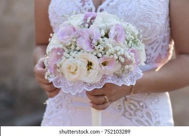 Beautiful wedding bouquet in bride's hands. Pastel colors