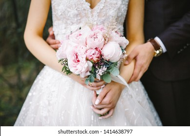 beautiful wedding bouquet close up and bride