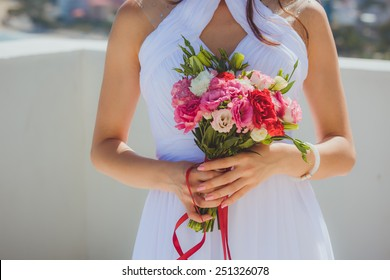 Beautiful wedding bouquet colourfull flowers n hands of the bride lovely day