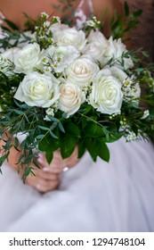 Beautiful wedding bouquet in hand of bride