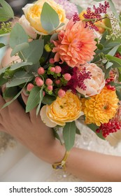 Beautiful wedding bouquet in hands of the bride, close up