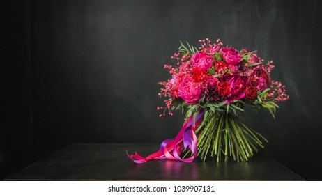 Beautiful wedding bouquet on the black background. Floristry and handmade concept