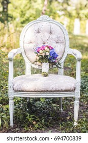 Beautiful wedding bouquet on a chair among nature