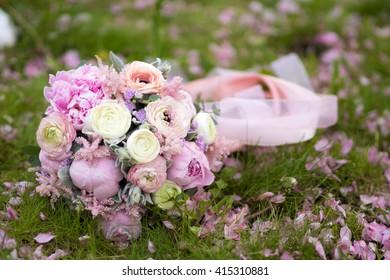 Beautiful wedding bouquet on the grass