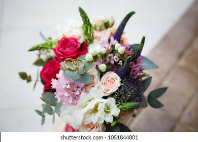 Beautiful wedding bouquet with rings on it