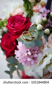 Beautiful wedding bouquet with rings on it close-up