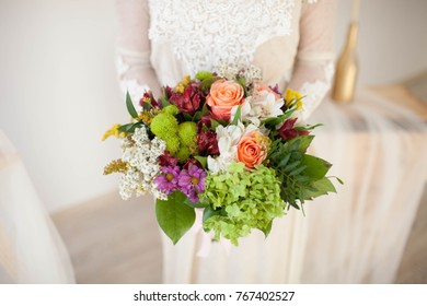beautiful wedding bouquet with roses in bride's hands. close-up