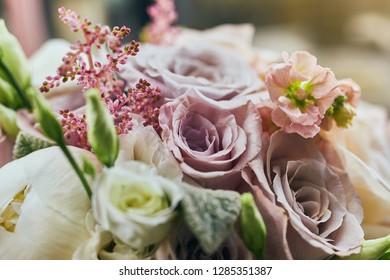 beautiful wedding bouquet with roses standing on the table