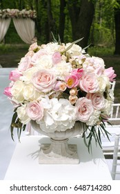 Beautiful wedding bouquet in stone vase, outdoors