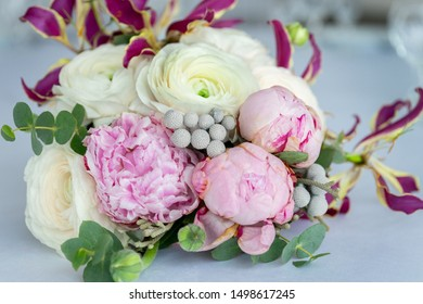 Beautiful wedding bouquet with white and pink roses is on the table