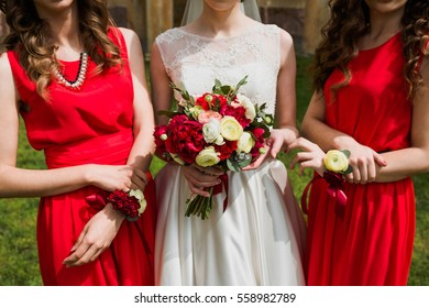 beautiful wedding bouquets in hands of the bride and bridesmaids